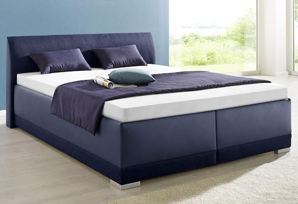 dunkelblaues Kunstlederbett auf universal.at