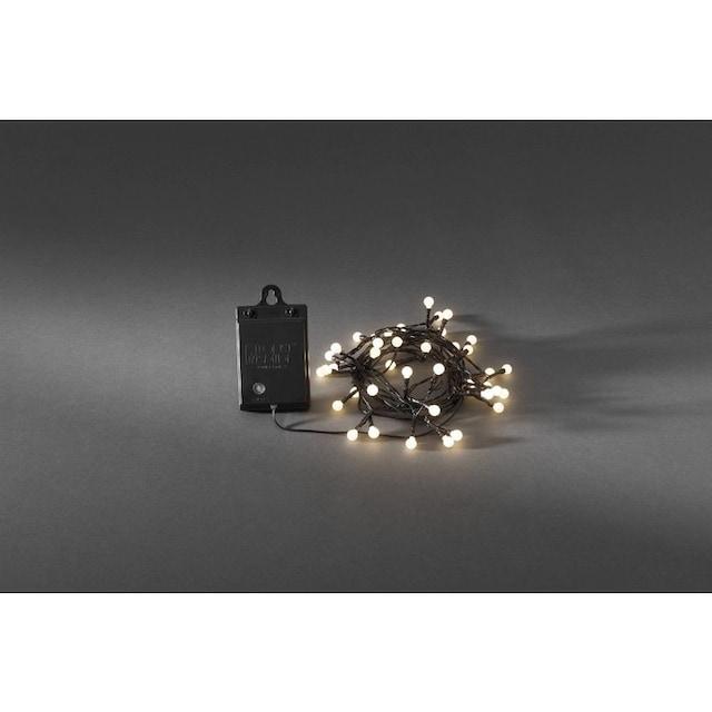KONSTSMIDE LED Globelichterkette mit Lichtsensor