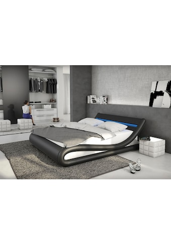 SalesFever Polsterbett, mit LED-Beleuchtung, Kunstleder, Design Bett in moderner Form kaufen