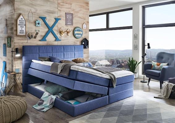 Polsterbett mit Bettkasten in Blau