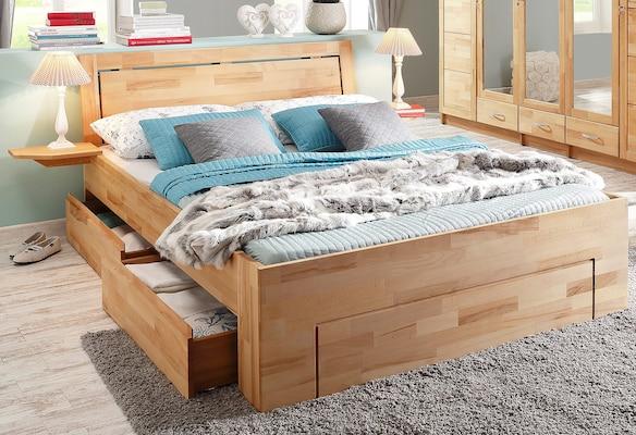 Doppelbett mit Stauraum aus hellem Holz