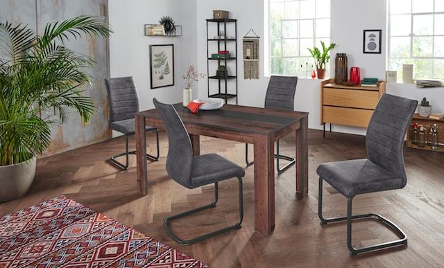 Essgruppe mit Holztisch und vier Freischwingerstühlen in Dunkelgrau